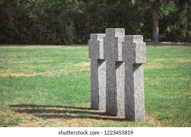 selective focus of old gravestones on grass at cemetery