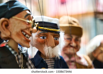 Selective focus of old sailor Puppets hanging at the souvenir store. Prague. Souvenir puppets (Marionettes)