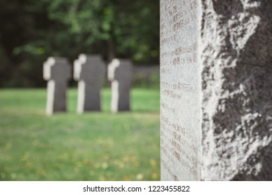 selective focus of old stone tomb with lettering at cemetery