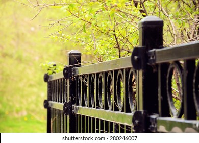 Selective focus on an aluminum fence with very shallow depth of field./ Black Fence