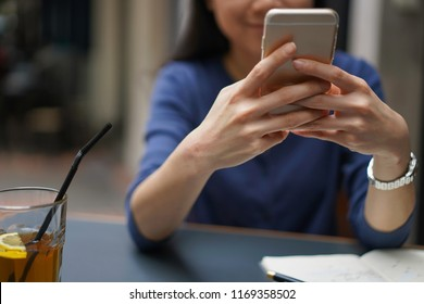 Selective focus on Asian girl using handphone