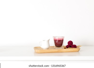 Selective focus on beetroot latte healthy coffee alternative and pink raspberry beetroot truffles close up, white background, copy space - gourmet dessert