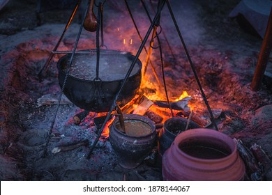 Selective focus on boiling cauldron with mysterious decoction on a campfire at night witch sabbath. Kupala Night, called in Poland Noc Kupaly, Cedynia - Shutterstock ID 1878144067