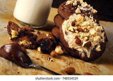 Selective focus on the cookie with sweet white chocolate cream and nuts