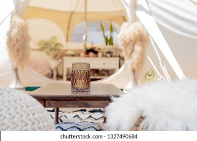 Selective focus on decoration in entrance of glamping tent and set up at Mount Maunganui