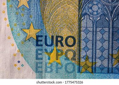 Selektiver Fokus auf die Einzelheiten der Euro-Banknoten. Nahaufnahme Makro-Detail der Geldbanknoten, 20 Euro einzeln. Konzept von Weltgeld, Inflation und Wirtschaft