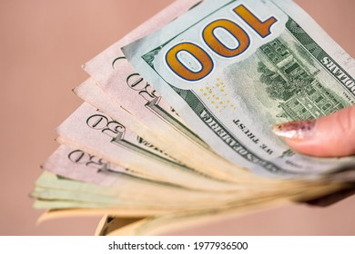 Selective focus on detail of USD banknotes. Counting or giving United States Dollars banknotes. World money concept, inflation and economy concept