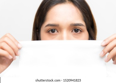 Selective focus on eyes of Beauty Asian women using a tissue to conceal half face feeling sadness, White toilet paper can write something.