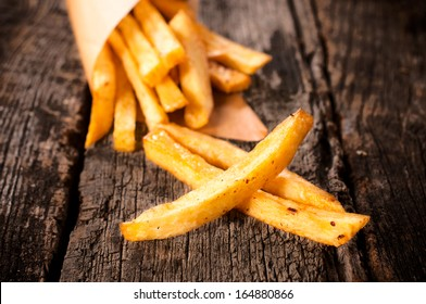 Selective focus on the front french fries on table