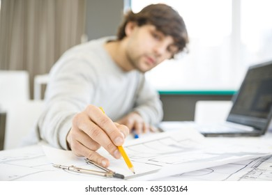Selective focus on the hand of a professional architect drawing up building plan with a pencil copyspace business creative profession career opportunity blueprints project startup development