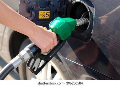 selective focus on hand that holding oil nozzle