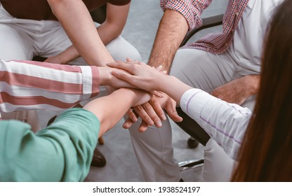 Selective focus on hands put together to show about unity, teamwork, power and success. Working and Business Concept.