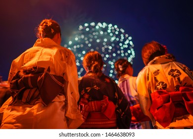 Selective focus on Japanese girls wearing kimono are seen viewing Fireworks in Karatsu, Saga Prefecture.