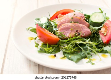 Selective focus on the juicy beef meat in plate