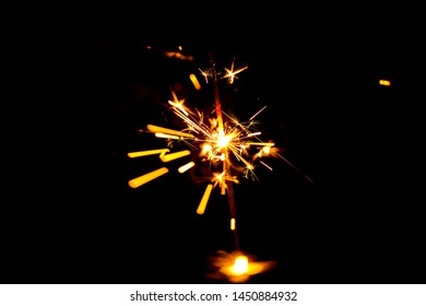 selective focus on light line of Sparklers in dark background.