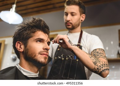 selective focus on man sitting in hair salon