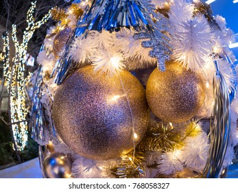 The selective focus on the middle of two balls decoration of the white christmas tree. The decoration is quite simple but still charming. There is also little bokeh on the tree. Merry Xmas