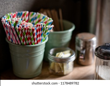 Selective focus on paper straws on a coffee bar counter with copy space