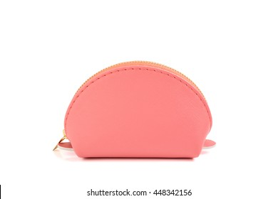 Selective focus on the pink round bag - isolated women cosmetic bag on white background