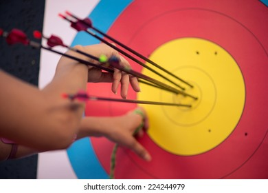 Selective focus on the pink target with colorful arrows in it