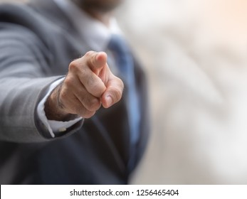 Selective focus on point finger of the blurry businessman with copy space to use.