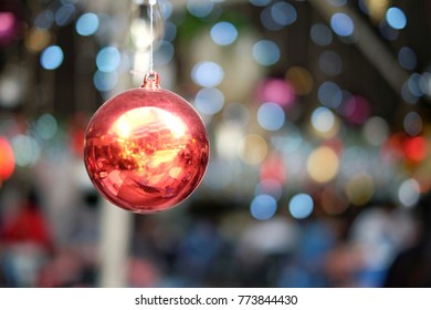 Selective focus on red ball / Christmas Ball and bokeh / Decorate Christmas party with ornaments  / background with colorful bokeh. / Merry Christmas and New Year Party concept