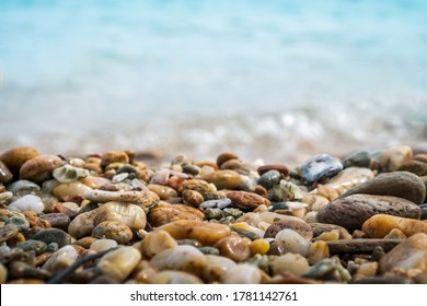 Selective focus on rocks texture with blur beach in background for display product.