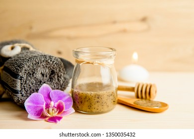 Selective focus on sauna honey scrub. Scrubbing honey and coffee mixture on body in hot sauna helps open the pores and renew, rejuvenate the skin on body. Sauna treatment concept.