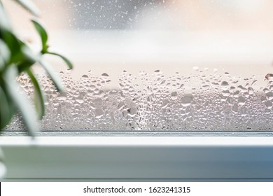 Selective focus on water condensation on window glass. Humidity in the house. Home moisture.