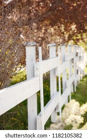 Selective focus on a white wooden fence.
