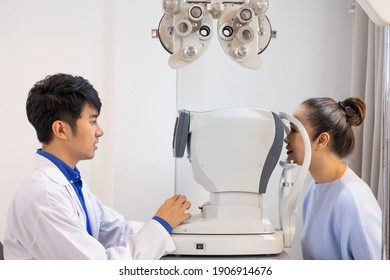 Selective focus at Optometry frame equipment. While doctor using penlight and subjective refraction to  examine eye visual system of elder patient women with professional machine before made glasses.