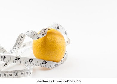 The selective focus of orange and measuring tape. Healthy and weight loss concept.
