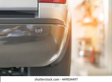 Selective focus parking sensor at rear car bumper on light  blurred background