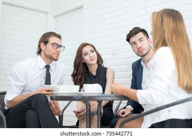 In Selective Focus of People.Group of  Businessman Meeting and Discuss in Coffee shop, Freelance Work Style, Outdoor Business Meeting Concept.