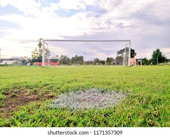 Selective focus Perspective image position of penalty shootout with blurred football goal in an outdoor football field.