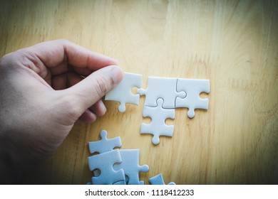 Selective focus of pieces puzzle jigsaw, puzzle background.