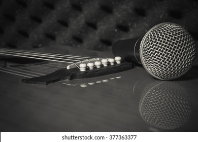 selective focus pin of classic guitar in home recording studio and Microphone.
