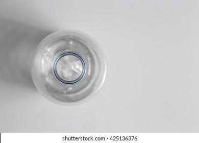 Selective focus of plastic water bottle, top view