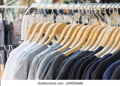 selective focus point clothes hang on a shelf