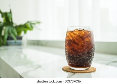 Selective focus point Iced cola glass in restaurant