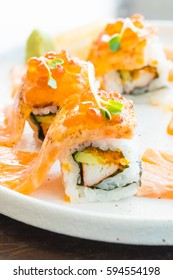 Selective focus point on grilled salmon sushi roll in white plate - Japanese food style