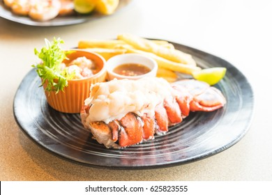 Selective focus point on Lobster steak in black plate
