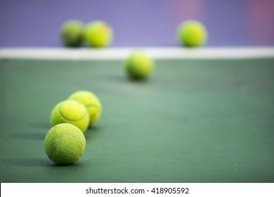 selective focus point on old practice balls on tennis court