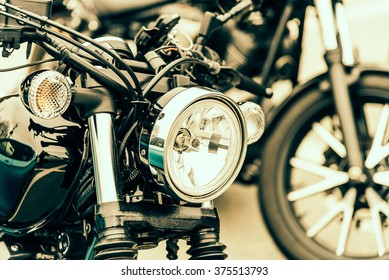 Selective focus point on vintage headlight lamp motorcycle - Vintage filter Processing