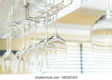Selective focus point on Wine's glass hanging on bar
