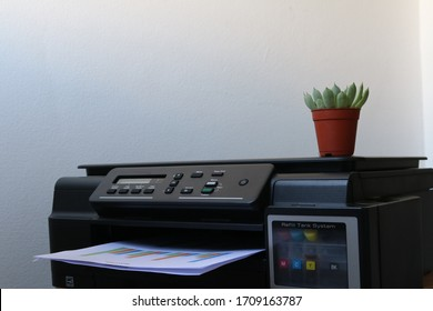 Selective focus Printer. Closeup laser printer or scanner. Business man press button on panel of printer in office. Working in office. Office equipment. Printer in office for working space concept.