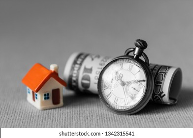 Selective focus real estate financial concept, dollar bank note and pocket watch.  Investment with money and time.