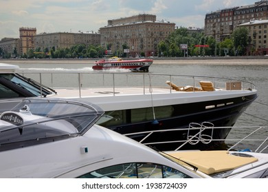 """Selective focus. Retro hydrofoil boat """"Rocket"""" on the Moscow River on a summer day against the background of yachts and multi-storey buildings. Promenade. Selective focus. Russia. Moscow 2008.06.20"""