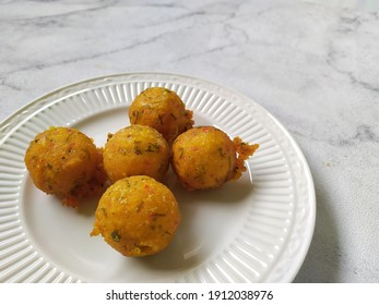 Selective focus of Sala lauak is a fried food typical of Pariaman, West Sumatra, which is made from brownish yellow rice flour.