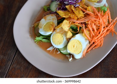 Selective focus of salad with boil egg, crispy fried potato and mix vegetable